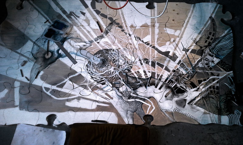 about 1/2 done drawing the jigsaw puzzle drawing in my studio